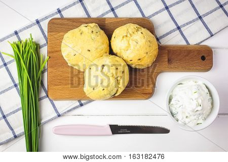 Fresh homemade wholegrain bread with a chive spread