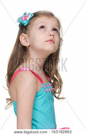 Little Girl Looks Up On The White Background