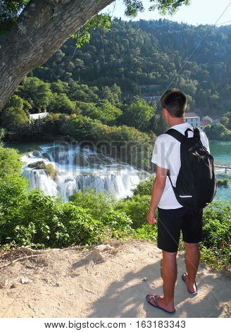 The guy admiring the waterfalls from the top to Krka National Park.