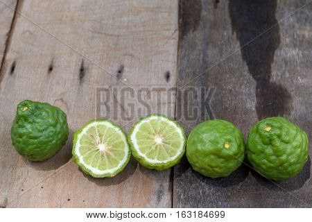 Kaffir Lime or Bergamot on wood background.