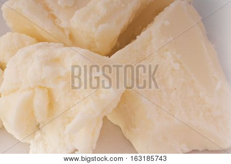 Pieces of shea butter closeup. Shea butter for skin care.