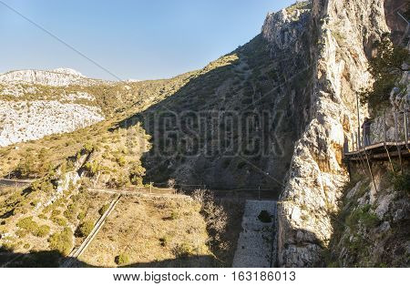 Malaga Spain - December 6 2016: Hiker woman walking along the Caminito del Rey path Malaga Spain