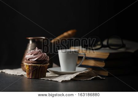 Cup Of Coffee And Cupcake. Time To Read An Interesting Book. Time To Relax.