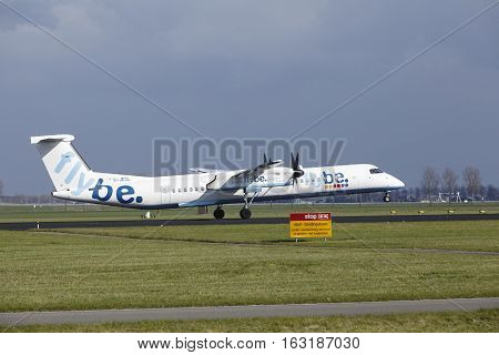Amsterdam Airport Schiphol - Flybe Bombardier Dash 8 Lands