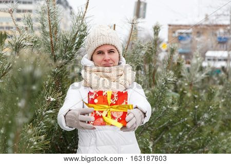 The Happy Girl Holds A Gift