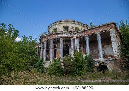 Abandoned ruins of manor of Earl Voeikov, facade with columns. Penza Region, Russia