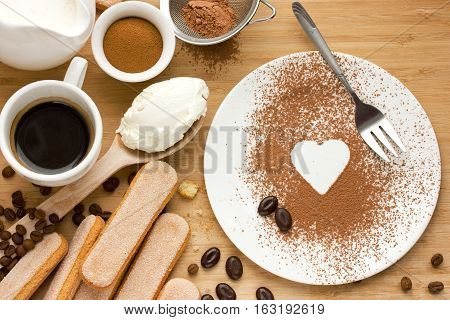 Ingredients for tiramisu on a wooden table top view , traditional Italian dessert tiramisu cooking