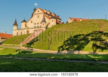 Nesvizh Belarus - August 20 2016:Nesvizh Castle is a residential castle of the Radziwill family. Cobblestone road to the castle.