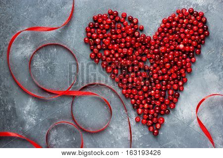 Heart of berries red heart of cranberry love and health concept top view
