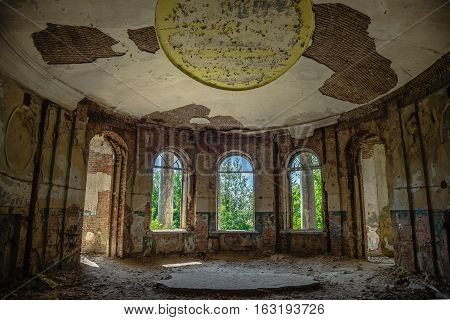 Interior of ruined round hall of an abandoned mansion Earl Voeikov