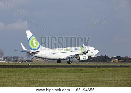 Amsterdam Airport Schiphol - Transavia Boeing 737 Lands