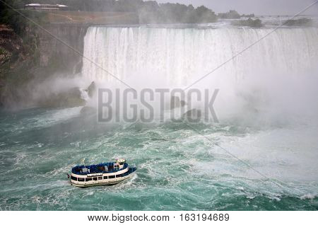 Maid of the Mist at the bottom of American Falls in Niagara Falls, New York State, USA.