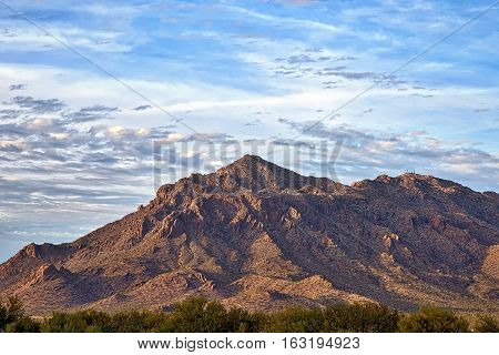 The setting sun on the Picacho Mountains and Newman Peak in southern Arizona