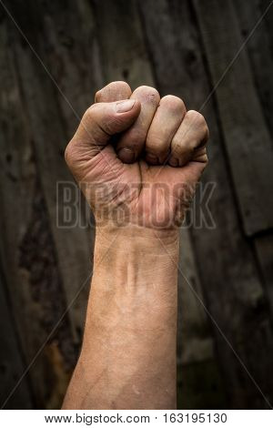 The hand of an adult male clenched.
