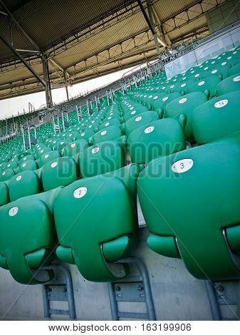 Multiple lines of green stadium plastic seats