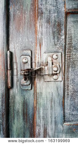Old door lock and latch in vintage wardrobe
