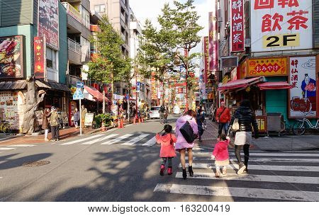 People Walking On Street In Yokohama