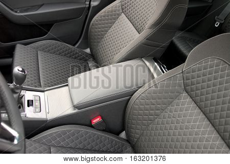 armrest in the luxury passenger car, detail in the interior