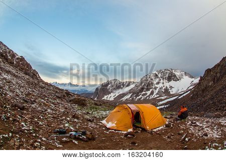 Tourist near a tent in the mountains of Tien Shan, Kazakhstan