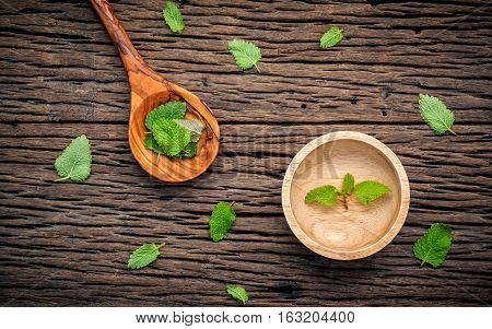 Fresh Lemon Balm ( Melissa Tincture) Leaves In Spoon And Wooden Bowl Setup With Flat Lay On Shabby W
