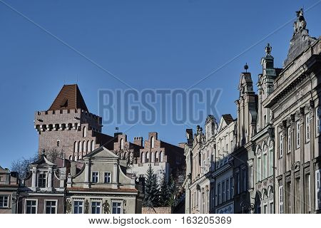 Townhouses in the Old Market Square and the tower of the Royal Castle in Poznan