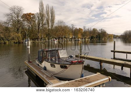 An image of a boat moored on the banks of the River at Henley on Thames Oxfordshire England UK