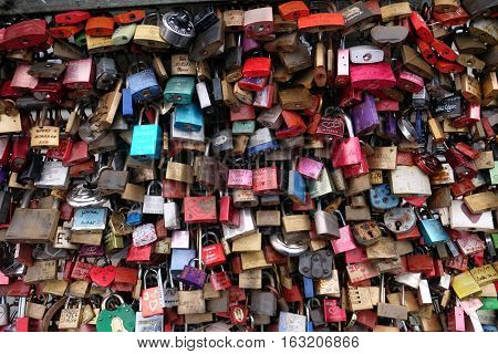 Cologne, Germany - March 6, 2016 : Love padlocks on the Hohenzollern Bridge in Cologne. More Thousand padlocks are there. People bring them to this place because it should bring luck in love an life.
