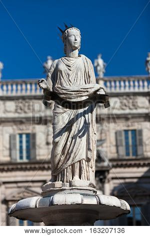 Ancient Sculpture Madonna Verona on Piazza delle Erbe - the town's forum during the time of the Roman Empire. Palazzo Maffei in the background