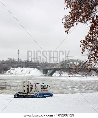 Amphibian rescue boat on the shore of a frozen channel, the Russian rescue boat.Hovercraft.
