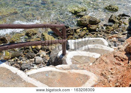 Staircase on the coast of Cretan Sea near Hersonissos Crete Greece.