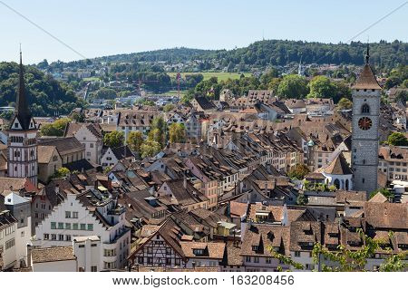 Ancient city Schaffhausen Switzerland. Panorama of city form Munot fortress . Top view of roofs of houses and the town hall.