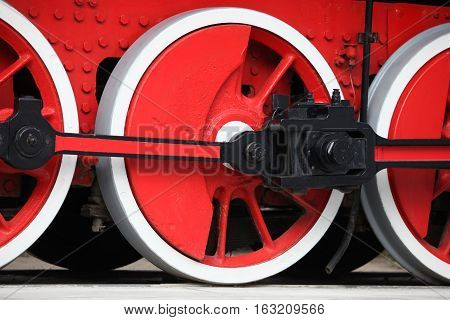 red wheel of an old steam locomotive