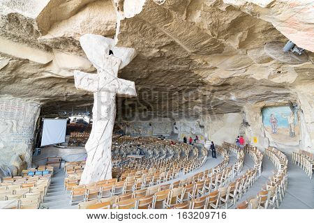 Cairo, Egypt - December 18, 2016: St. Samaan the Tanner Hall with a big cross, part of a huge cave discovered in 1974 in Saint Samaan The Tanner Monastery, and prepared later to contain the hall and St. Mark's Church