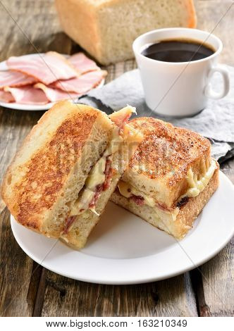 Grilled cheese sandwich for breakfast and cup of coffee