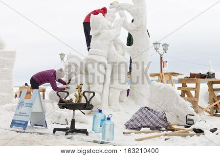 PETROZAVODSK, RUSSIA - FEBRUARY 20TH, 2016: masters sculpt a snow sculpture on the International Winter Festival