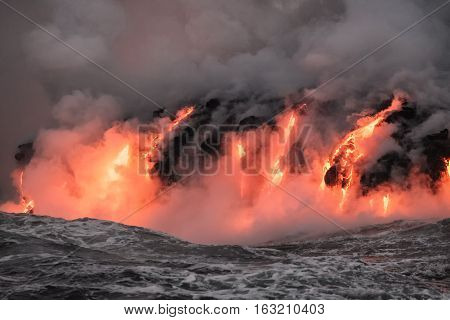 Molten lava flowing into Pacific Ocean from the Kilauea lava flow on Big Island of Hawaii