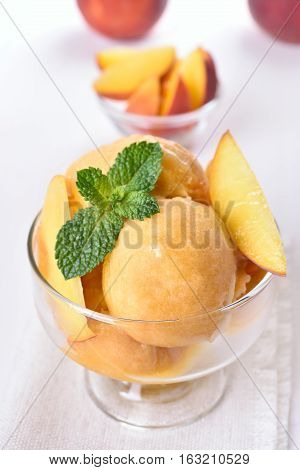 Apricot peach ice cream in glass bowl