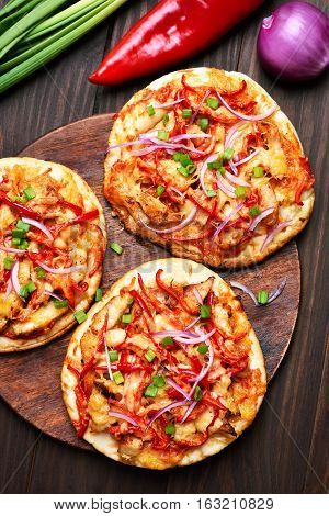 Pizza with chicken meat and vegetables top view