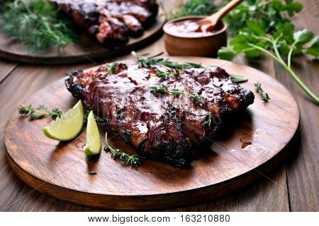 Grilled pork ribs on wooden board shallow depth of field