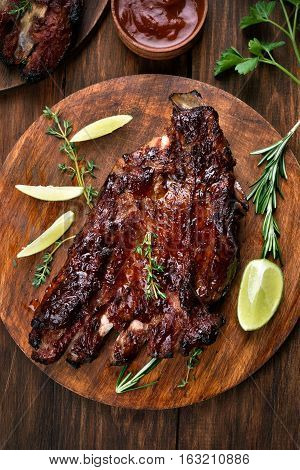 Barbecue pork ribs on wooden board top view