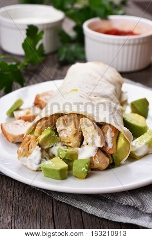 Homemade chicken fajitas with meat and avocado