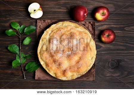 Apple pie and fruits on wooden table top view