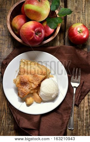 Apple pie served with ice cream. Fruit baking top view