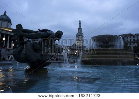 trafalgar square at dusk in london in england