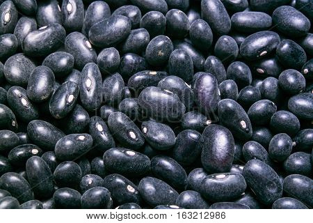uncooked black bean background, backdrop or texture