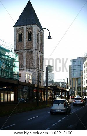 COLOGNE, GERMANY - NOVEMBER 24: Street traffic on the Pipin Street in front of the tower of the Little Saint Martin church in Cologne old town on November 24, 2016 in Cologne.
