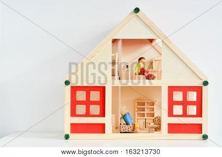 Close-up of girls dollhouse isolated on white background