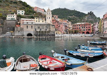 VERNAZZA, ITALY - DECEMBER 2016: Small fishing port with parked boats at Vernazza town in Cinque Terre national park, Liguria, Italy