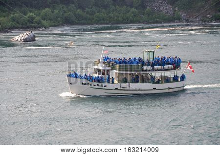NIAGARA FALLS, NEW YORK, USA - JUL 21, 2011: Maid of the Mist heading to Niagara Falls, New York State, USA.
