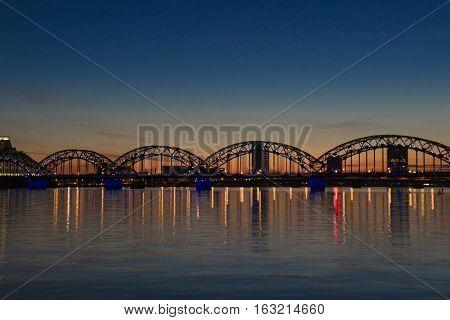 Night panoramic scene in Riga, Latvia at river Daugava